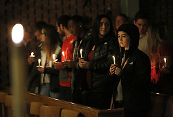 November 28, 2016 - Columbus, OH, USA - Guests stand for a moment after lighting their candles during a prayer vigil at St. Stephen's Episcopal Church, near where a violent attack happened on Monday, Nov. 28, 2016 on the Ohio State campus. (Credit Image: © Jonathan Quilter/TNS via ZUMA Wire)