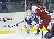 University of Nebraska-Omaha's Rich Purslow (9) checks LSSU's Simon Gysber (left) away from the puck during the second period of the Lakers and Mav's Friday night game at Taffy Abel Arena in Sault Ste. Marie, Michigan.