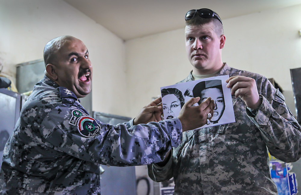 Sgt. Duncan at an Iraqi Police station in Baghdad, Iraq helping the police chief teach raqi police during a training class.