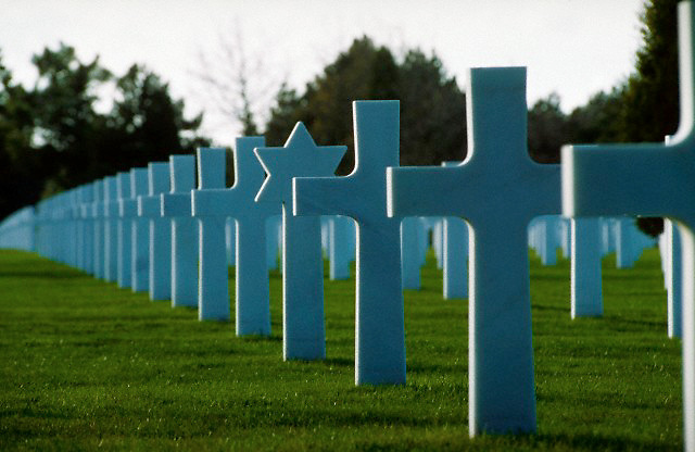 March 1994 --- Rows of crosses and a Star of David headstone at the American cemetery in Omaha Beach, Normandy, France. --- Image by © Owen Franken/Corbis