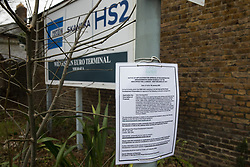 London, UK. 24 January, 2020. A notice indicated a site designated for the HS2 project at Old Oak Common. A new station, which would be one of the largest rail hubs in London, is planned for the High Speed Two rail link at Old Oak Common. Cost projections for the project are reported to have risen to £106bn and the Transport Secretary Grant Shapps has confirmed that the Government will make a decision regarding its viability in February 2020.