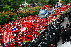Thousands of Thai red shirt protesters are seen during a stand-off with riot police, army and navy officers at the ASEAN summit venue of the Pattaya Exhibition and Convention Hall (PEACH) demanding the current government step down, on the first day of the Association of South East Asian Nations (ASEAN) plus six summit, in Pattaya, Thailand, about 160 km south east of Bangkok, Thailand, 10 April 2009. Thailand hosts the ASEAN plus three and six summits including leaders of China, Japan, South Korea, India, Australia, and New Zealand, with South East Asian leaders, from April 10 to 12.
