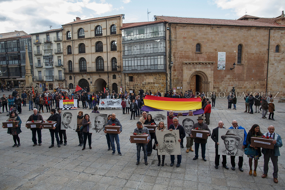 14/04/2018. Relatives and supporters hold coffins containing the bodies of victims of Spain Civil War and portraits depicting them during a homage to hand the remains to their families on April 14, 2018 in Soria, Spain. La Asociacion Soriana Recuerdo y Dignidad (ASRD) 'The Soria Association for Memory and Dignity' celebrated a tribute to hand over the remains of civil war victims to their families. The Society of Sciences of ARANZADI helped with the research, exhumation and identification of the bodies, after villagers passed the information about the mass grave, 81 years after the assassination took place, to the ASRD. Seven people were assassinated around August 25, 1936 by Falangists, as part of General Francisco Franco armed forces, and buried in the 'Fosa de los Maestros' (Teachers Mass Grave) near Cobertelada, Soria, after being taken from prison of Almazan during the Spanish Civil War. Five of them were teachers in the region, and also friends of Spanish writer Antonio Machado. The other two still remain unidentified. Another body was assassinated by Falangists accompanied by a priest in 1936, and was exhumed on 23 September of 2017 near Calata&ntilde;azor, Soria. It belonged to Abundio Andaluz, a politician, lawyer and musician in Soria.<br /> Spain's Civil War took the lives of thousands of people on both sides, and civilians. But Franco continued his executions after the war has finished. Teachers, as part of the education sector, were often a target of Franco's forces. Spanish governments has never done anything to help the victims of the Civil War and Franco's dictatorship while there are still thousands of people missing in mass graves around the country. (&copy; Pablo Blazquez)