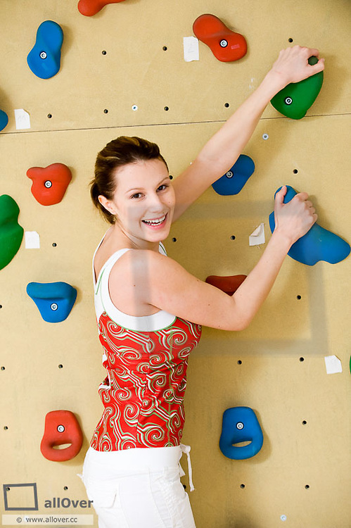 Young woman in climbing wall (model-released)