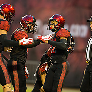 12 October 2018: San Diego State Aztecs running back Chase Jasmin (22) is congratulated by teammates after scoring on a four yard run in the first quarter giving the Aztecs a 7-0 lead. The San Diego State Aztecs lead 14-9 at the half against the Air Force Falcons at SDCCU Stadium Friday night.