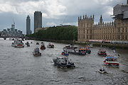 New vista of Nine Elms development in background, Flotilla of Ffshermen and campaigners for the 'Leave' campaign demonstrate in boats outside the Houses of Parliament in London, The Brexit battle took to London's River Thames as boats supporting the 'Leave' and 'Remain' campaigns jostled for space, while Bob Geldof harangued U.K. Independence Party leader Nigel Farage using a sound system. 15 June 2016