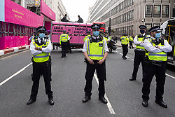 © Licensed to London News Pictures. 03/09/2020. London, UK. Police officers form cordon as Animal Rebellion protesters dump a pink truck outside the Department of health in Victoria St.  The protesters have fixed themselves outside and inside the truck. Photo credit: Ray Tang/LNP