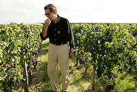 Harvest at Chateau Petrus<br /> <br /> Christian Moueix, the owner, tasting grapes for quality control, and decisions about harvest time - photo from 2004