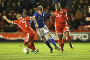 Andy Cannon is challenged by Adam Chambers during the EFL Sky Bet League 1 match between Walsall and Rochdale at the Banks's Stadium, Walsall, England on 6 March 2018. Picture by Daniel Youngs.