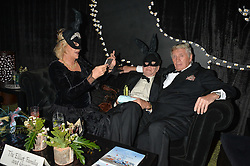 Left to right, ANNABEL ELLIOT, SIMON ELLIOT and DON McCULLIN at The Animal Ball presented by Elephant Family held at Victoria House, Bloomsbury Square, London on 22nd November 2016.