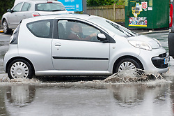 © Licensed to London News Pictures. 30/09/2019. Builth Wells, Powys, Wales, UK. A car park has large flood puddles in the Welsh market town of Builth Wells in Powys, UK. Photo credit: Graham M. Lawrence/LNP