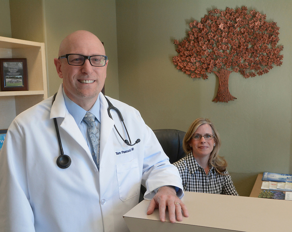 gbs031517e/BUSINESS -- Dr. Tom Pascuzzi with his wife Shannon Pascuzzi who is also his receptionist at his business GoPrivateMD. He offers concierge healthcare to individuals on a monthly membership plan. He takes no insurance, and offers 24/7 access.(Greg Sorber/Albuquerque Journal)