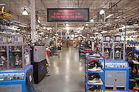 A electronic sign tells employees how many hand made shoe were made in the week at Allen Edmunds shoe Company sit on a shelf at the companies headquarters in Port Washington, Wisconsin April 12, 2011.  Darren Hauck