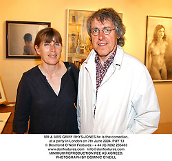 MR & MRS GRIFF RHYS-JONES he is the comedian, at a party in London on 7th June 2004.PUY 13