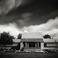 While clouds swirl above, the Hollyhock stands firmly atop Olive Hill in the Los Feliz neighbourhood of Hollywood, CA. The house was built by Frank Lloyd Wright for Aline Barnsdall. Olive Hill is now called Barnsdall Park.