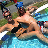 Alyssa Hodgson and Brandon Ray from Ocala, Florida relax in their pool prior to the 57th Annual NASCAR Coke Zero 400 stock car race at Daytona International Speedway on Sunday, July 5, 2015 in Daytona Beach, Florida.  (AP Photo/Alex Menendez)