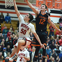 Laura Stoecker/lstoecker@dailyherald.com<br /> Batavia's Eric Peterson sinks a shot past St. Charles East's Evan DiLeonardi (12) in the second quarter of the Class 4A regional championship in St. Charles Friday.