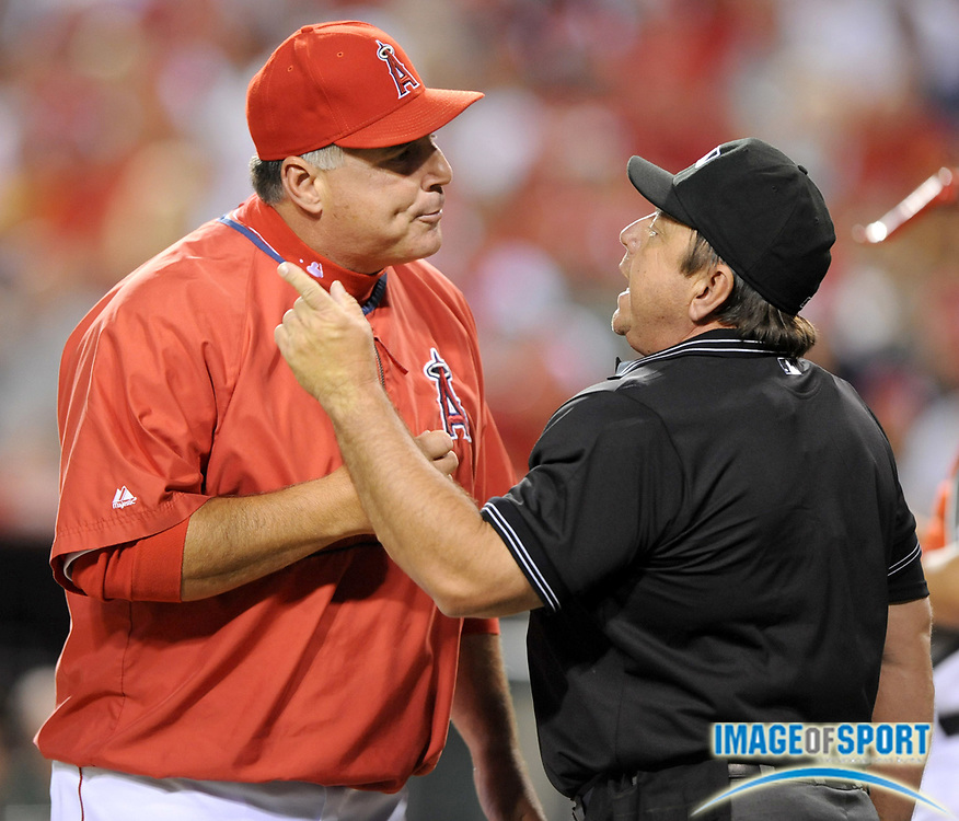 Apr 28, 2007; Anaheim, CA, USA; Los Angeles Angels manager Mike Scioscia (14) argues with home plate umpire Charlie Reliford during the third inning against the Oakland Athletics at Angel Stadium. Mandatory Credit: Kirby Lee/Image of Sport-US PRESSWIRE