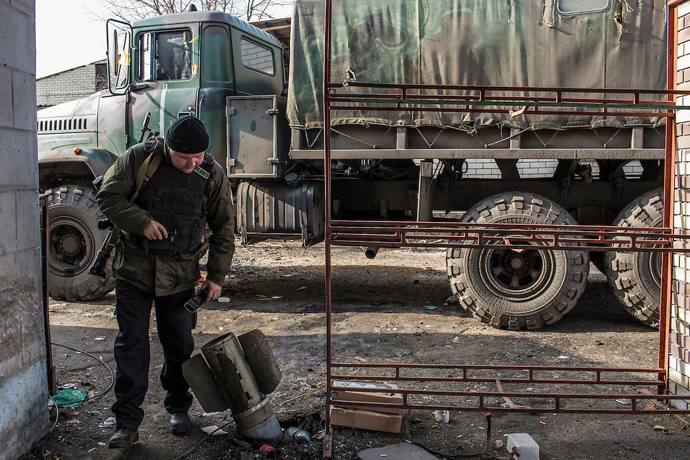 DEBALTSEVE, UKRAINE - FEBRUARY 8, 2015: A Ukrainian Army medic shows a rocket that landed near their medical point in Debaltseve, Ukraine. Fighting between pro-Russia rebels and Ukrainian forces there over the past two weeks has dealt steady casualties to Ukrainian fighters and civilians. CREDIT: Brendan Hoffman for The New York Times