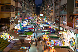 Night view of traditional street market on Fa Yuen Street in Mongkok , Kowloon, Hong Kong.