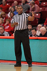29 November 2014:  Referee Winston Stith during an NCAA men's basketball game between the Youngstown State Penguins and the Illinois State Redbirds  in Redbird Arena, Normal IL.