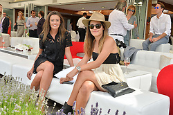 Left to right, ISABELLA O'DUFFY and STEPHANIE CARNEY at the Audi International Polo at Guards Polo Club, Windsor Great Park, Egham, Surrey on 26th July 2014.