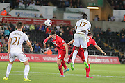 defender Eddie Nolan wins the header against forward Eder during the Capital One Cup match between Swansea City and York City at the Liberty Stadium, Swansea, Wales on 25 August 2015. Photo by Simon Davies.