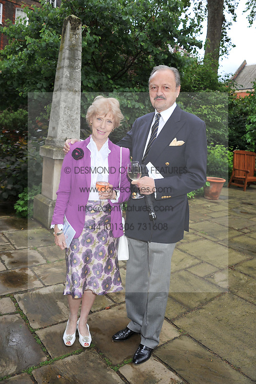 PETER BOWLES and his wife SUE at The Lady Taverners 25th Anniversary Westminster Abbey Garden Party held in The College Gardens, Westminster Abbey, London o 11th July 2012.