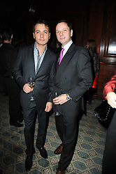 Left to right, JUAN CREDIDIO and KARL DUNKLEY at the launch of Grosvenor Shirts luxury collection to celebrate the 2010 FIFA World Cup in South Africa held at 88 St.James's Street, London SW1 on 8th December 2009.