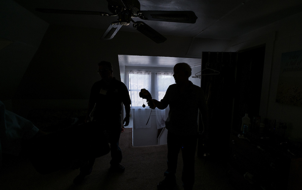 Mike Lehman uses a thermal camera inside the attic apartment at 86 West State Street during an energy audit Wednesday, June 24, 2015.  Photo by Ohio University  /  Rob Hardin