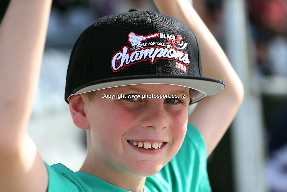 A young Black Sox fan at game three of the Trans Tasman Softball Series between the New Zealand Black Sox and the Australian Steelers at Tradestaff Rosedale Park in Albany, Auckland on 29 March 2014. Photo: Jason Oxenham / www.photosport.co.nz