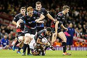 Ospreys wing Keelan Giles is tackled during the European Challenge Cup match between Ospreys and Stade Francais at Principality Stadium, Cardiff, Wales on 2 April 2017. Photo by Andrew Lewis.