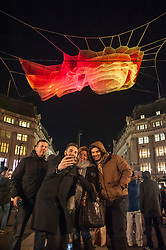 "© Licensed to London News Pictures. 14/01/2016. London, UK. ""1.8 London"" by Janet Echelman / Studio Echelman above Oxford Circus.  The work forms part of Lumiere London, a major new light festival which commenced today to be held over four evenings and featuring artists who work with light.  The event is produced by Artichoke and supported by the Mayor of London.  Photo credit : Stephen Chung/LNP"