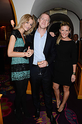 """Left to right, OLIVIA """"Bubble' PERRY, JAMIE RICHARDS and ANNA MACKINTOSH at a 1970's themed party as part of Annabel's 50th anniversary celebrations, held at Annabel's, Berkeley Square, London on 24th September 2013."""