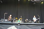 June 16, 2006; Manchester, TN.  2006 Bonnaroo Music Festival..Oysterhead, who is singer/guitarist Trey Anastasio (Phish), singer/bassist Les Claypool (Primus), and drummer Stewart Copeland (The Police) performs at Bonnaroo 2006.  Photo by Bryan Rinnert