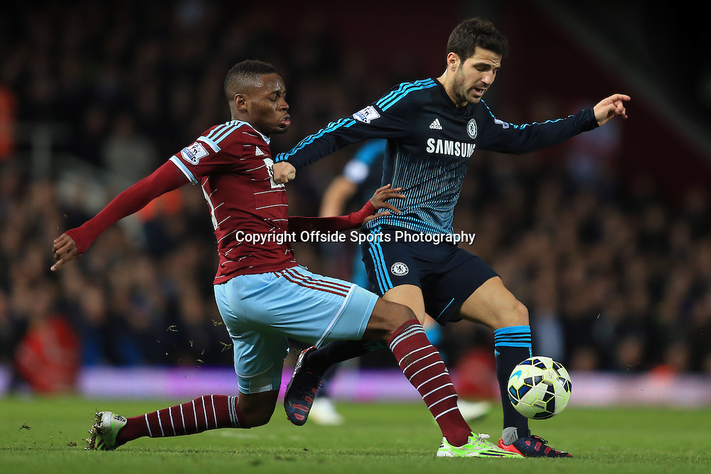 4 March 2015 - Barclays Premier League - West Ham United v Chelsea - Diafra Sakho of West Ham tangles with Cesc Fabregas of Chelsea - Photo: Marc Atkins / Offside.