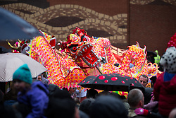 © Licensed to London News Pictures . 22/02/2015 .  Manchester , UK . The dragon in Manchester's China Town . Crowds stand out in the snow to watch Chinese New Year celebrations in Manchester today ( Sunday 22nd February 2015) . Photo credit : Joel Goodman/LNP