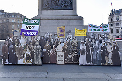 """© Licensed to London News Pictures. 06/02/2018. LONDON, UK.  A pop-up exhibition featuring 59 life-sized images of campaigners, along with famous rallying slogans such as """"deeds not words"""" takes place in Trafalgar Square marking 100 years since the Representation of the People Act was passed, granting some women over the 30 in the UK the right to vote for the first time.  Photo credit: Stephen Chung/LNP"""