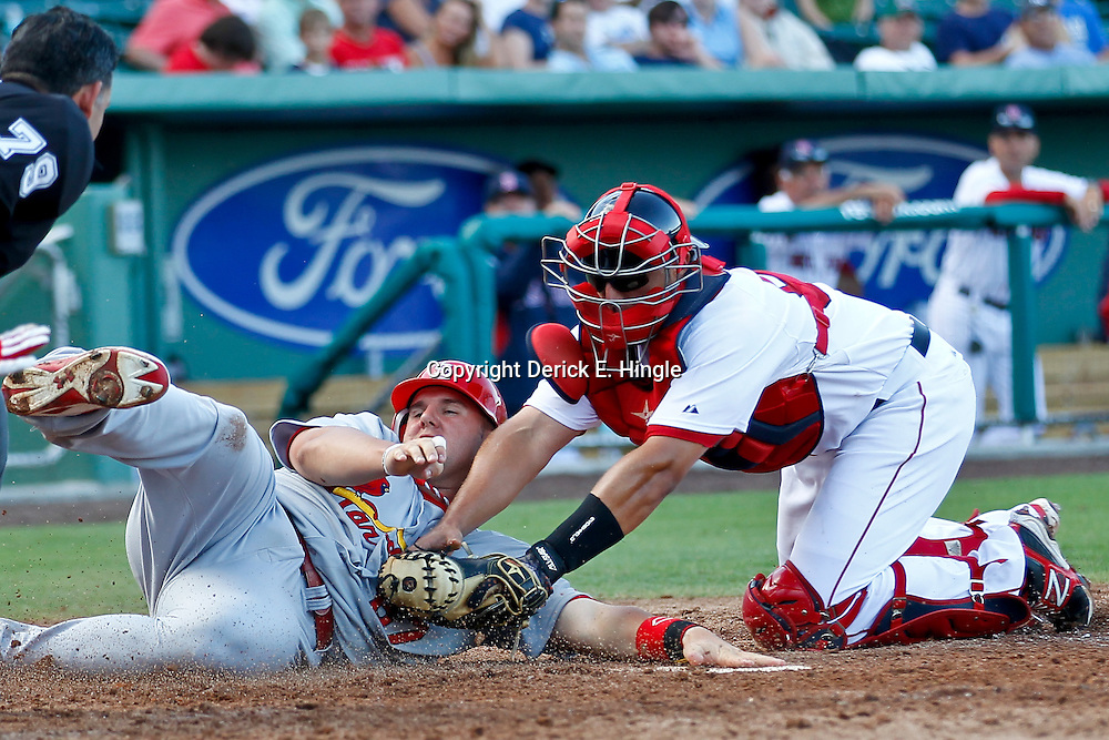 March 15, 2012; Fort Myers, FL, USA; St. Louis Cardinals first baseman Matt Adams (87) is tagged out by Boston Red Sox catcher Luis Exposito (92) during the top of the eighth inning of a spring training game at Jet Blue Park. Mandatory Credit: Derick E. Hingle-US PRESSWIRE
