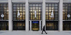 A pedestrian walks past the National Bank of Belgium, in Brussels. Photograph © Jock Fistick