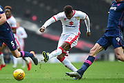 Milton Keynes Dons striker Kieran Agard (14) takes a shot at goal during the EFL Sky Bet League 1 match between Milton Keynes Dons and Portsmouth at stadium:mk, Milton Keynes, England on 10 February 2018. Picture by Dennis Goodwin.