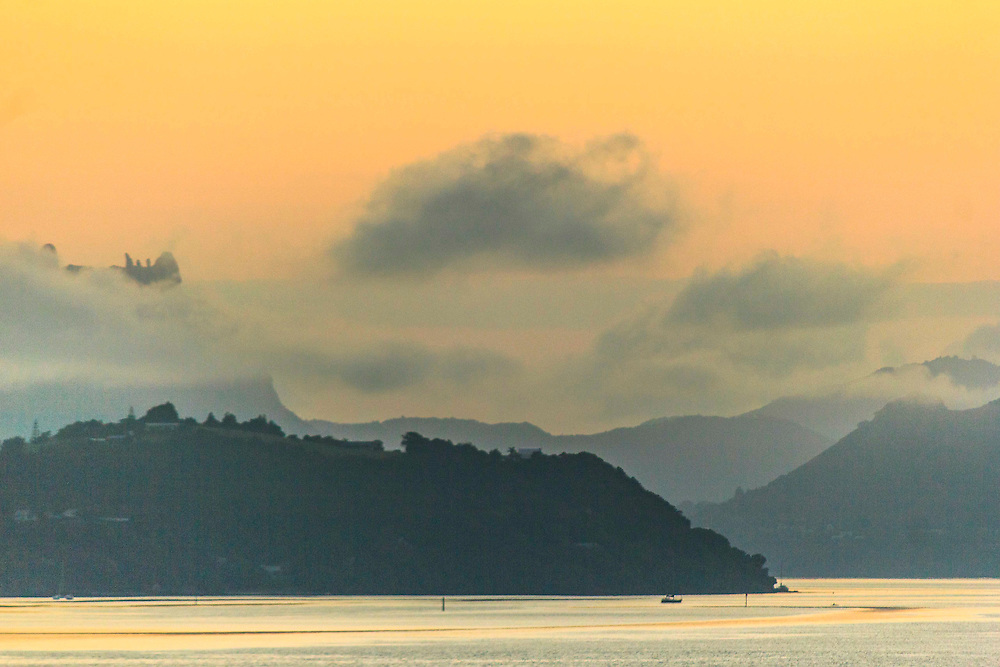 Whangarei Harbour, Mt Manaia and Tamaterau covered by early morning cloud.