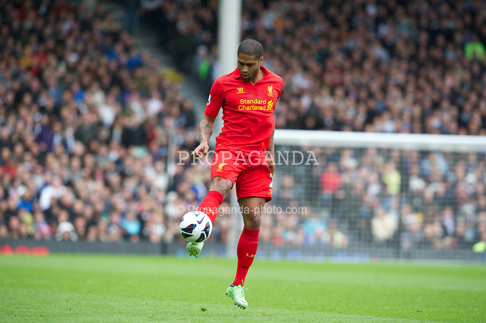 LONDON, ENGLAND - Sunday, May 12, 2013: Liverpool's Glen Johnson in action against Fulham during the Premiership match at Craven Cottage. (Pic by David Rawcliffe/Propaganda)
