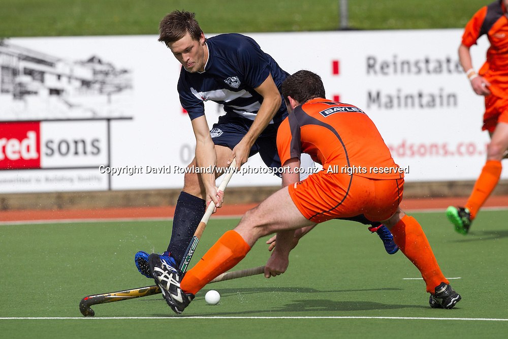 Auckland`s Marcus Child is challenged by Midland`s Ian Daniel in the Auckland v Midlands Men`s Final match, Ford National Hockey League, North Harbour Hockey Stadium, Auckland, New Zealand,Sunday, September 14, 2014. Photo: David Rowland/Photosport