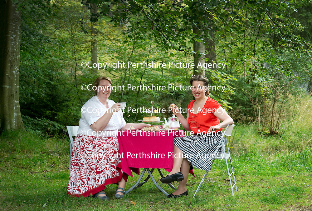 Tricia Fox (left) co-ordinator for Fife Outdoor Access Festival and Nicola Martin, Hettie's Tea Room stir up the past ahead of this weekend's Turn Back Time @ Tentsmuir event at Tentsmuir Forest in Fife.<br /> For futher info contact Tricia Fox on 01738 658187<br /> Picture by Graeme Hart.<br /> Copyright Perthshire Picture Agency<br /> Tel: 01738 623350  Mobile: 07990 594431