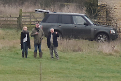 © Licensed to London News Pictures. 26/12/2014. Heythrop Hunt on Boxing Day rode through the land of BBC Top Gear presenter Jeremy Clarkson at his farm which he has named as Diddly Squat Farm just outside the village of Chadlington in Oxfordshire. Jeremy Clarkson has submitted planning permission to redevelop the main house into a mansion earlier in the year. The farm is just a few miles away from his county home (and where his wife lives) just out side of Chipping Norton.Photo credit : MARK HEMSWORTH/LNP