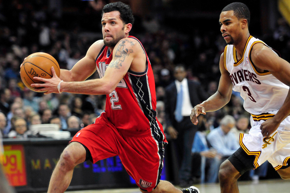 March 23, 2010; Cleveland, OH, USA; New Jersey Nets point guard Jordan Farmar (2) drives past Cleveland Cavaliers point guard Ramon Sessions (3) during the third quarter at Quicken Loans Arena. The Nets beat the Cavaliers 98-94 in overtime. Mandatory Credit: Jason Miller-US PRESSWIRE