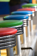 Colourful stools sit empty, waiting for the next players of the Rising Waters race game at the Playland amusement park in Vancouver, British Columbia
