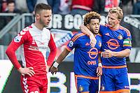 UTRECHT - FC Utrecht - Feyenoord , Voetbal , Seizoen 2015/2016 , Eredivisie , Stadion de Galgenwaard  , 28-02-2016, Speler van Feyenoord Dirk Kuyt (r) bedankt de belangrijke man van de assist Speler van Feyenoord Tonny Vilhena (l) na de 1-2 terwijl FC Utrecht speler Bart Ramselaar (l) teleurgesteld is