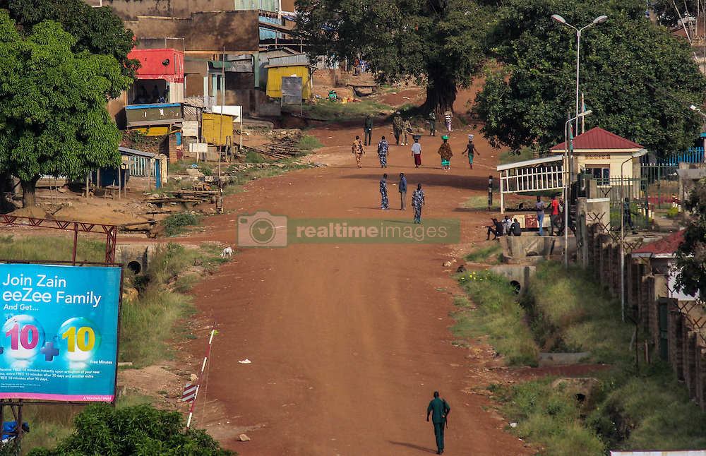 SPLA soldiers walk around empty streets in Kaya Town. The Kaya Town (South Sudan) and Oraba (Uganda) border resembles a ghost town after fighting broke out last Wednesday between rebel forces and SPLA soldiers. Shots and dead bodies could be seen from accross the border. More fighting is expected this week. More than 300,000 South Sudanese refugees have fled from the country's civil war into Uganda since fighting broke out in July. They mostly travel by foot for days through the bush as roads have been blocked or are too dangerous to cross. The massive influx of refugees has caused a strain in humanitarian aid due to large numbers and lack of funding. BidiBidi settlement is now the third largest in the world and holds more than 210,000 people since its opening in September.